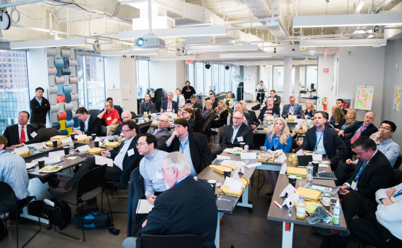 Mark Huang (Standing, Left) working with startups at SeaAhead in Boston.
