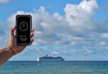 compass-on-phone-with-ship-in-background-f9d34189