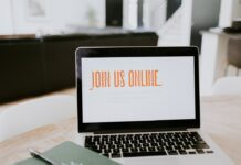 laptop-with-join-us-online-on-screen-4c321258